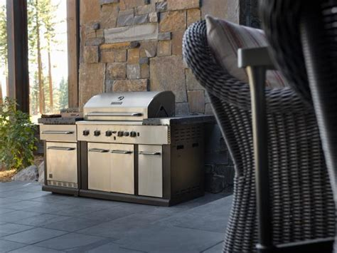 Wide Gas Grill Sits at Outdoor Patio Stone Wall   HGTV